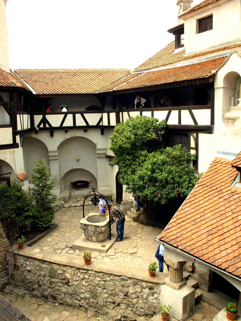 The inner courtyard of the castle with a well