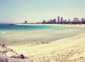 Al Mamzar Beach in Dubai, Sharjah city in distance, UAE.