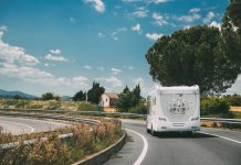 White Caravan Motorhome Car Goes On Highway Road