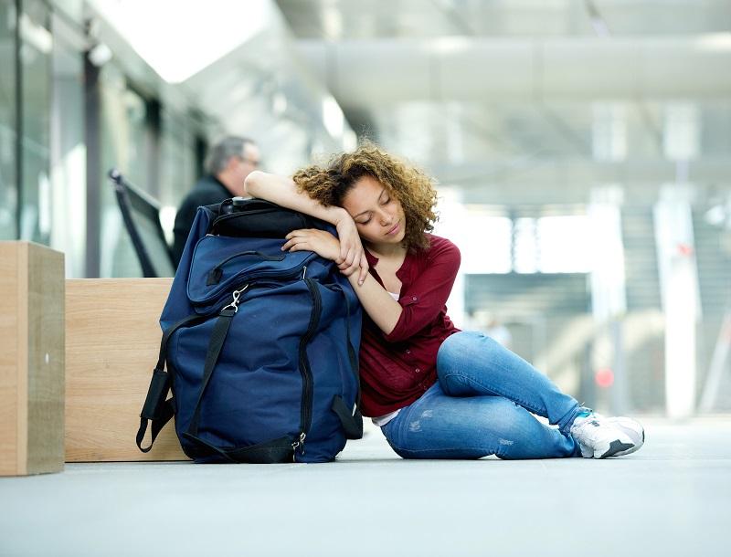 Young woman sleeping at airport