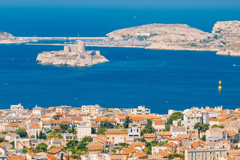 Marseille, France. Elevated view Of cityscape and If Castle in Marseilles, France. Sunny summer day with bright blue sky