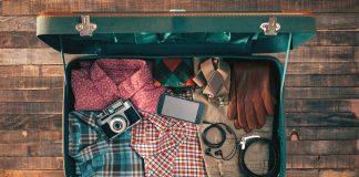 Hipster traveler packing