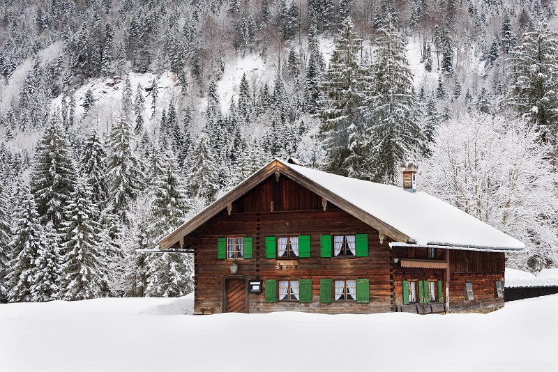 Wooden house in Bavaria in the snow