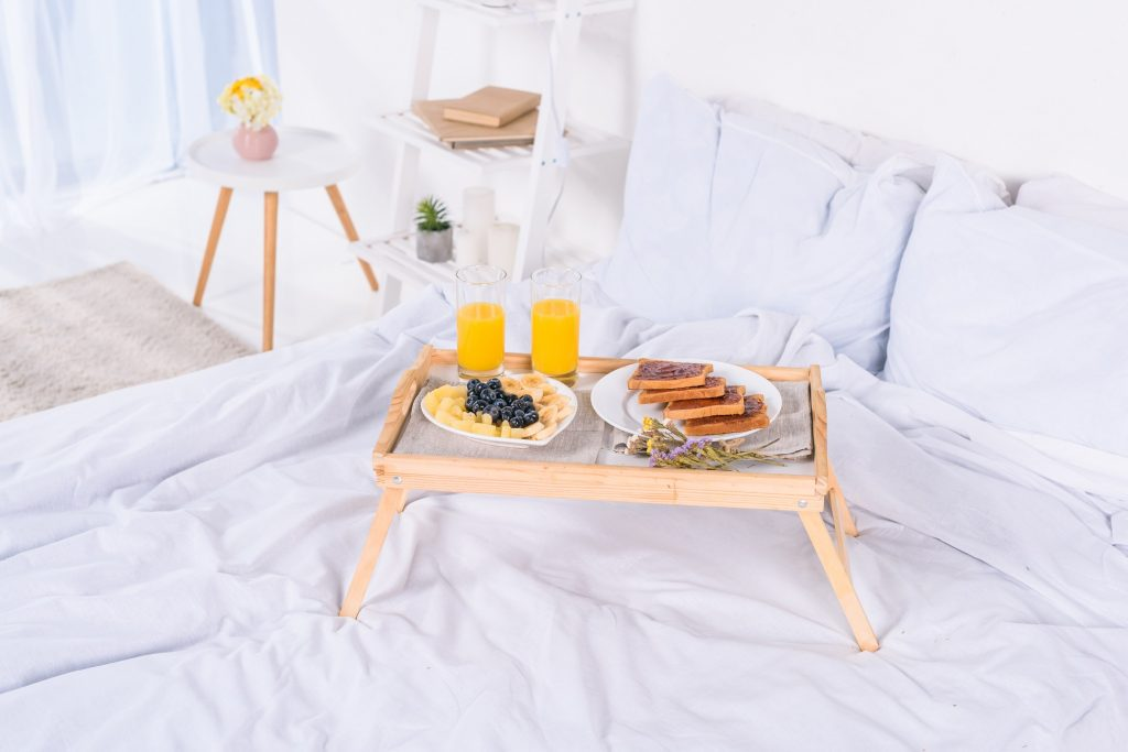 breakfast in bed on wooden tray at morning