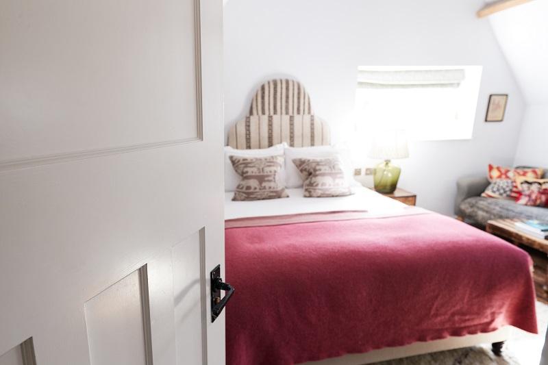 Interior Of Guest Room In Bed And Breakfast Hotel Viewed Through Door