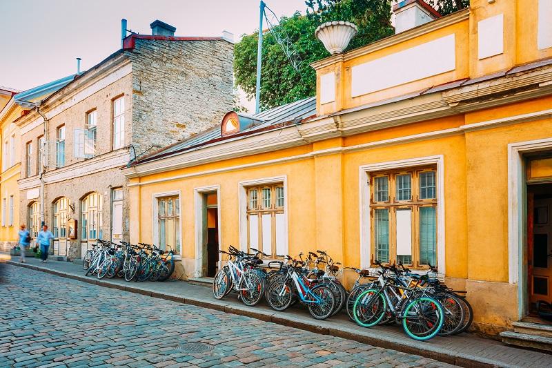 Tallinn, Estonia. Bicycles Rental Bikes Parking Near Old House