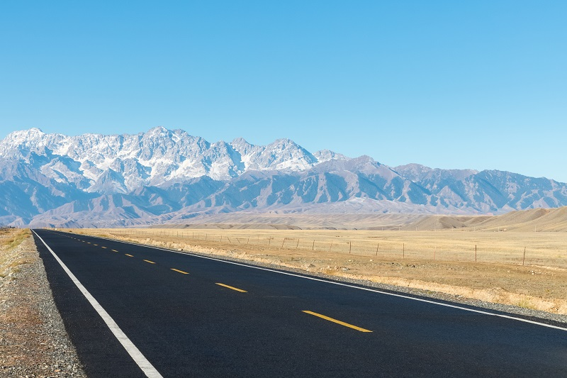 asphalt road on wilderness
