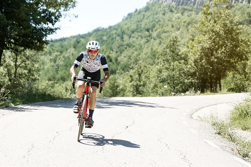 Men cycling mountain road at morning