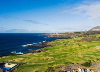 Golf course near the Atlantic ocean in Tenerife, Spain, green Golf course, tennis court in the nature of Tenerife