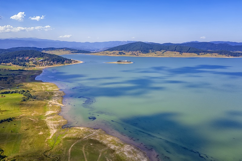 Scenic aerial view with a drone of an amazing Batak dam, Bulgaria with crystal water