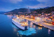 Aerial view of cruise ship at harbor at night
