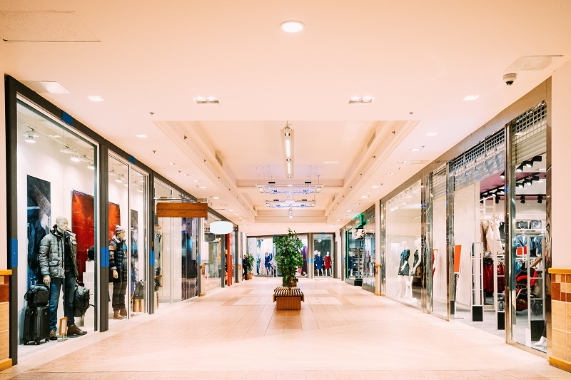 Shops with clothes at the modern shopping mall Shopping Centre.