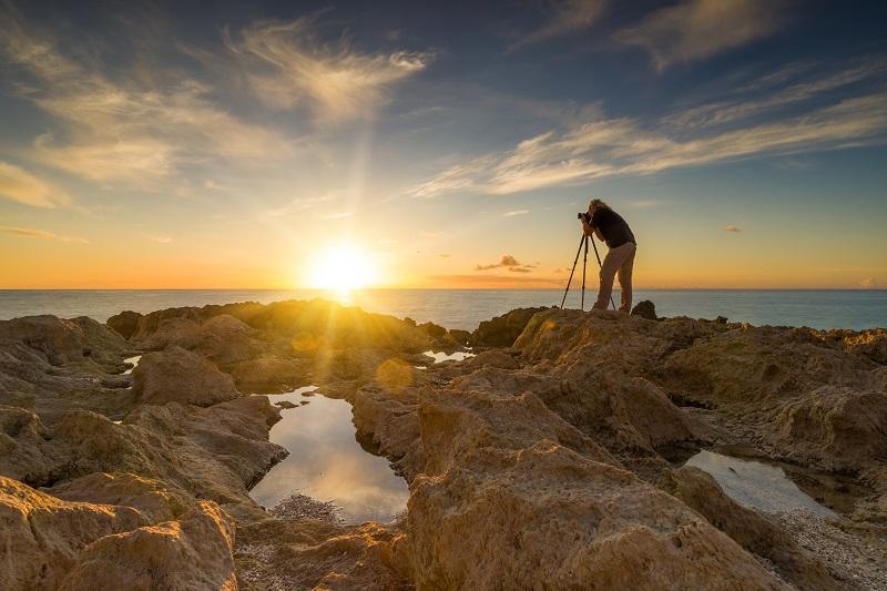 landscape photographer taking photos of the sunset