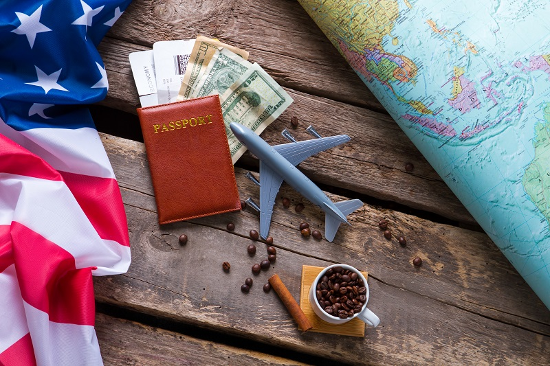 Passport near USA flag.