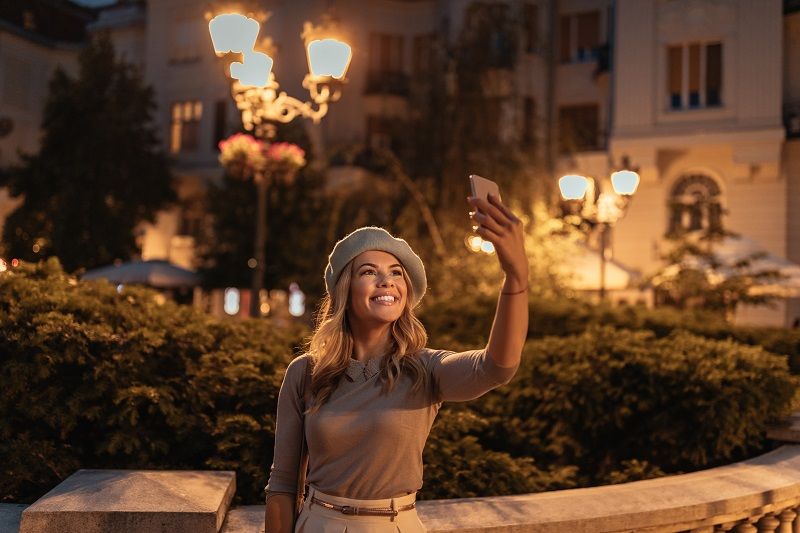 Taking a photo for her travel blog