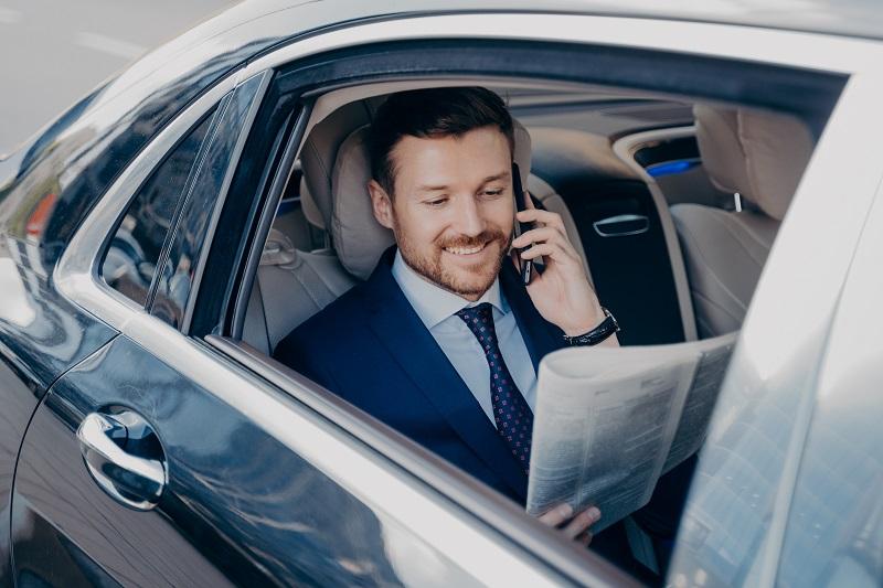 Elegant businessman in formal stylish wear traveling in luxury car